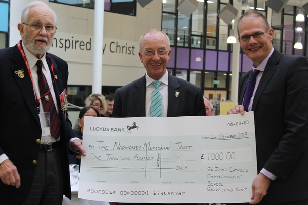 George Batts and Nicholas Witchell receiving cheque